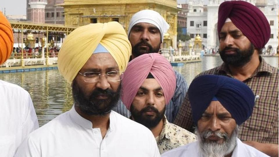 SAD leader Parminder Singh Dhindsa (Left) paying obeisance at the Golden Temple in Amritsar on Friday.