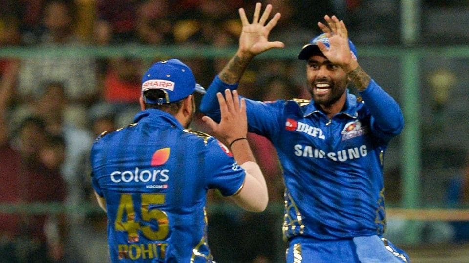 Mumbai Indians fielder Suryakumar Yadav (R) celebrates with his captain Rohit Sharma.