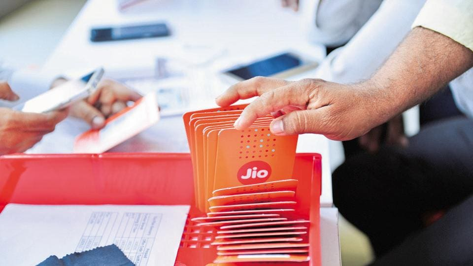 Customers buying Reliance Jio sims at a Reliance Digital centre in Mumbai .