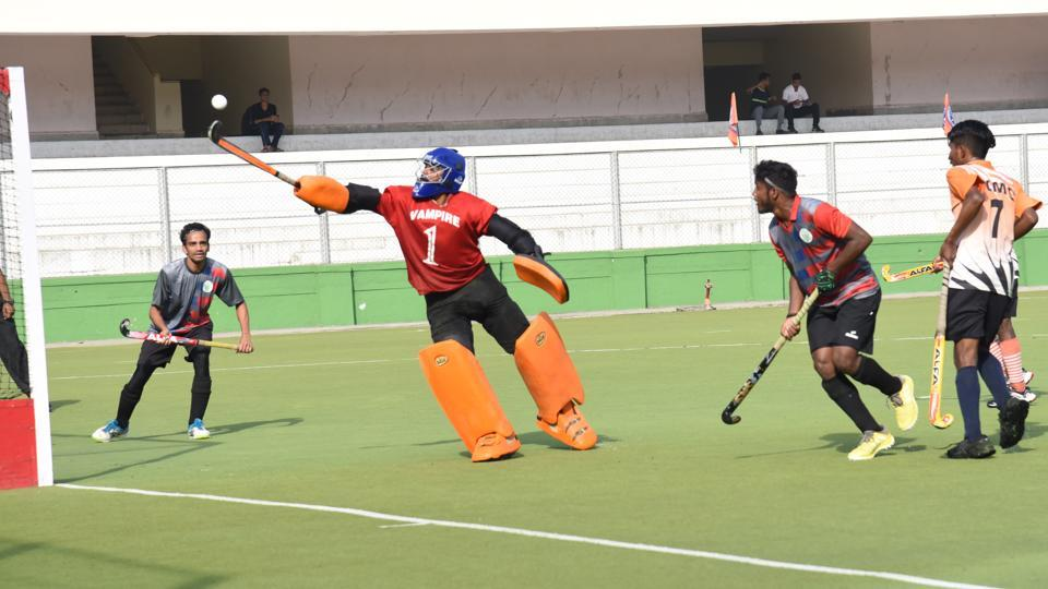 Pimpri Chinchwad Municipal Corporation (goalkeeper) in action against Food Corporation of India Pune during the first edition of Moti John hockey tournament at Dhyan Chand hockey stadium on Thursday.