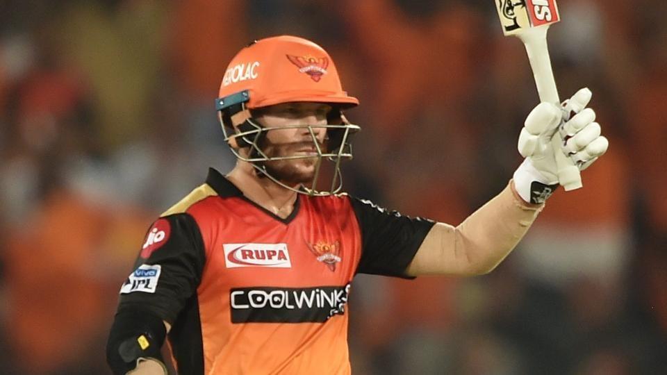 SRH batsman David Warner raises his bat after completing half-century during the Indian Premier League 2019.