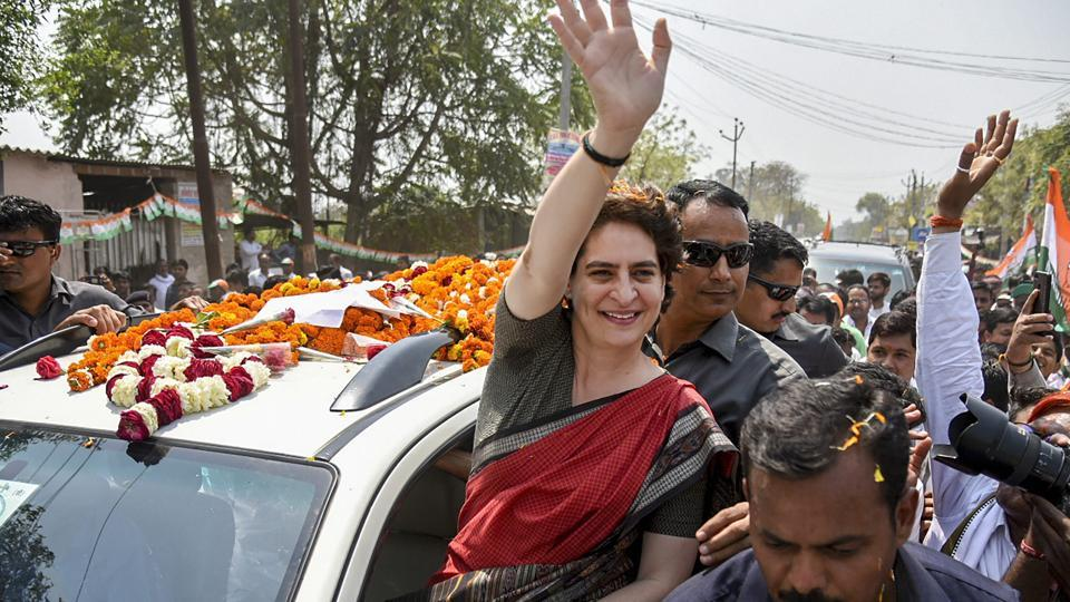 Congress General Secretary UP-East Priyanka Gandhi Vadra waves to her party supporters during a roadshow, ahead of Lok Sabha elections, at Kumarganj, in Faizabad on March 29, 2019.