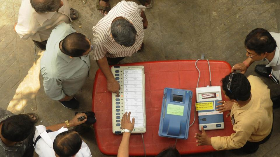 Kolkata, India - March 19, 2019: Directed by District Election Officer, as part of an awareness programme, officials show EVMs (Electronic Voting Machine) and VVPATs (Voter Verifiable Paper Audit Trail) to people near Shyambazar AV School, in Kolkata, West Bengal, India, on Tuesday, March 19, 2019.