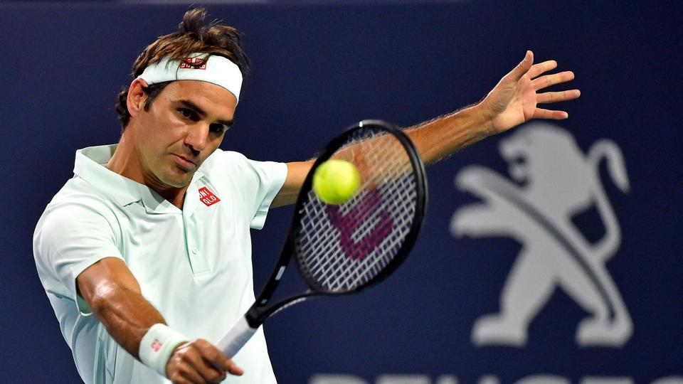 Roger Federer returns a shot against Kevin Anderson during their Miami Open clash.