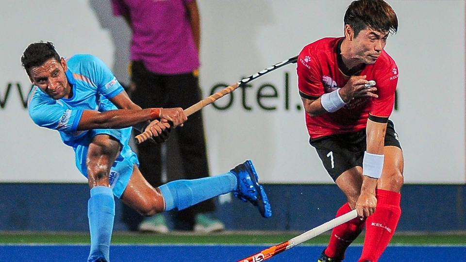 Indian hockey player Gurinder in action against Korea.
