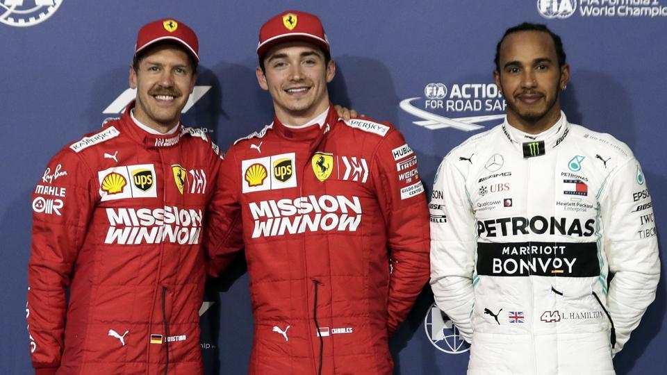 Ferrari driver Charles Leclerq of Monaco, center, Ferrari driver Sebastian Vettel of Germany, left, and Mercedes driver Lewis Hamilton.