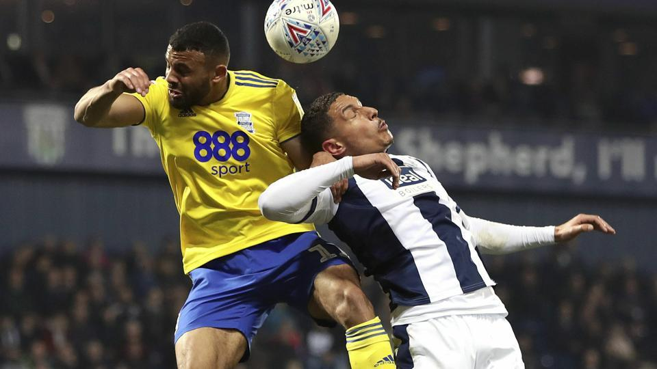 Birmingham City's Isaac Vassell, left, and West Bromwich Albion's Jake Livermore battle for a high ball.