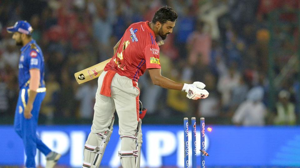 Kings XI Punjab cricketer K. L. Rahul takes off wicket bails after winning the match.