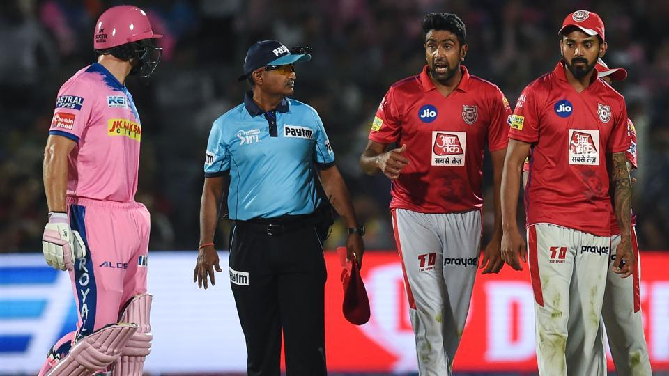 Rajasthan Royals' Jos Buttler (L) exchanges words with Kings XI Punjab's Ravichandran Ashwin (2ndR) .