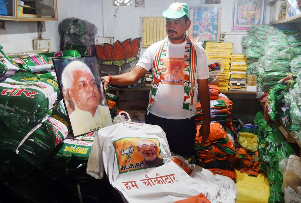 A seller is seen arranging election related material in his shop in Patna in this file photo. Mewa Lal Choudhary of the Janata Dal(United), Divya Prakash of the Rashtriya Janata Dal (RJD) and Mina Devi of the Lok Janshakti Party (LJP) are among those in the fray in Bihar's Tarapur assembly constituency.
