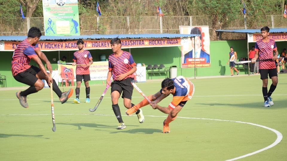 Sports Authority Gujarat (blue) in action against Pune City Line Boys  during the first edition of Moti John hockey tournament at Dhyan Chand hockey stadium on Friday.