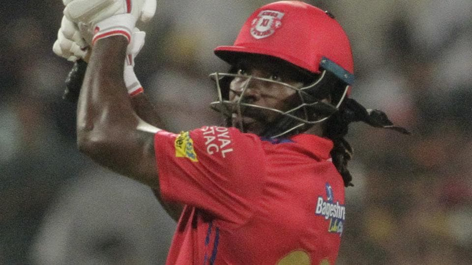 Kings XI Punjab's Chris Gayle looks back after hitting a ball.