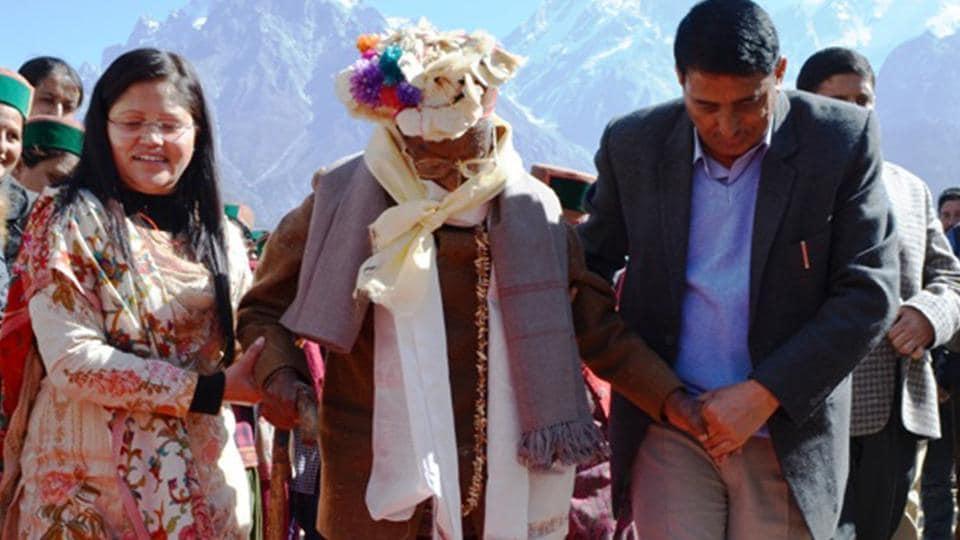 India's first voter,100-year-old Shyam Saran Negi, on his way to cast his vote, at Kalpa, in Kinnaur, Himachal Pradesh, India, on  November 9,  2017.