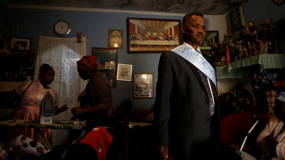 Retired Evaristo Marques, 75, prepares at his house to celebrate the day of Santa Catarina in Cova da Moura neighbourhood in Lisbon, Portugal. Marques, who was born in Cape Verde's capital Praia, doesn't see himself living anywhere else in Lisbon. (Rafael Marchante / REUTERS)