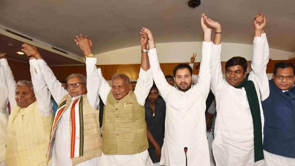 Rashtriya Janta Dal Leader Tejaswi Yadav , HAM (S) Chief Jitan Ram Majhi, VIP party chief Mukesh Shahni and others join hand during the Grand Alliance press conference ahead of Lok Sabha election 2019, in Patna,