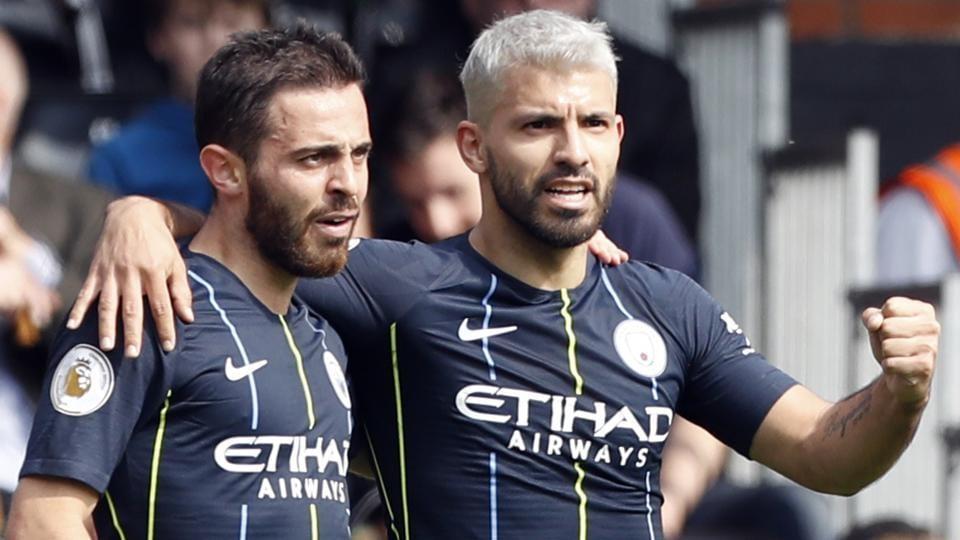 Manchester City's Sergio Aguero celebrates with teammate Bernardo Silva, left.
