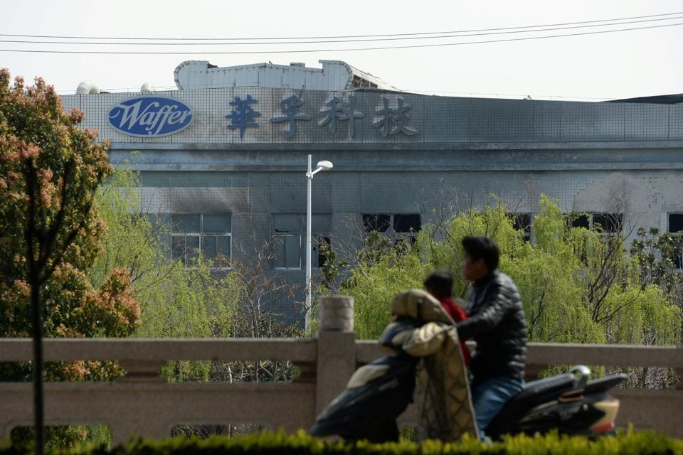 A man drives a motorbike past a damaged building of a metal-molding plant owned by Kunshan Waffer Technology Co following an explosion in Kunshan, Jiangsu province, China March 31, 2019.
