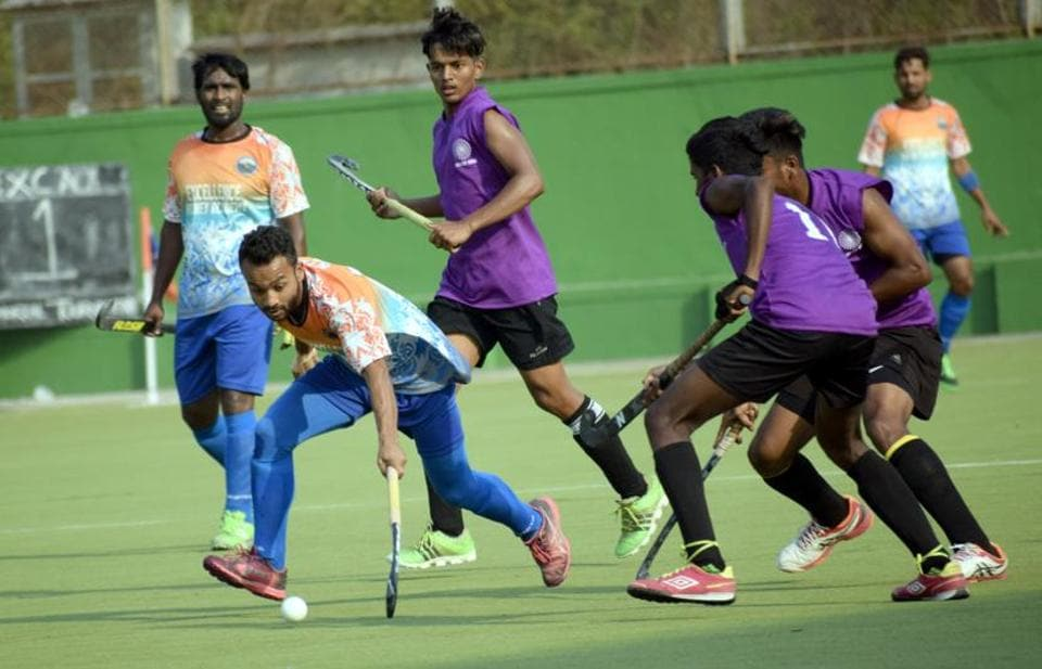 Excellency Academy (orange) in action against Rovers Academy during the first edition of Moti John hockey tournament at Dhyan Chand   on Saturday.