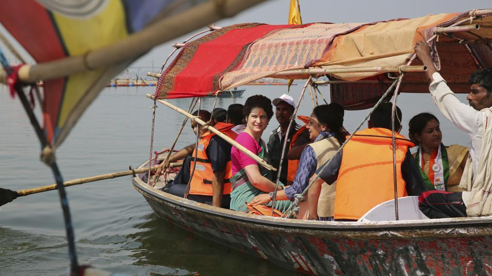 Congress party General Secretary and eastern Uttar Pradesh state in-charge Priyanka Gandhi Vadra, center, takes a boat ride to the Sangam, the confluence of sacred rivers the Yamuna, the Ganges and the mythical Saraswati, in Prayagraj, India, Monday, March 18, 2019. Gandhi kicked off her election campaign with a three day Ganges river ride to Varanasi. (AP Photo/Rajesh Kumar Singh)