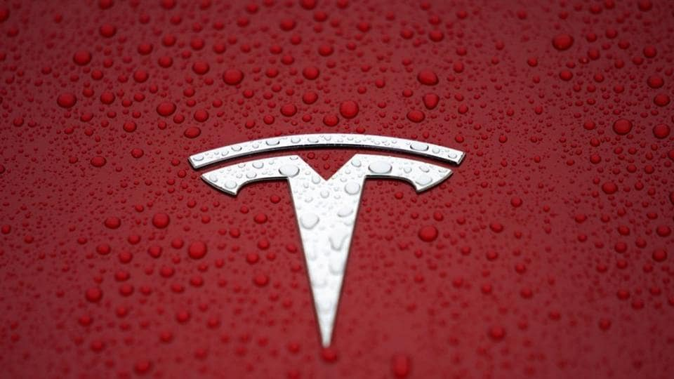FILE PHOTO: A Tesla logo is seen at a groundbreaking ceremony of Tesla Shanghai Gigafactory in Shanghai, China January 7, 2019. REUTERS/Aly Song/File Photo
