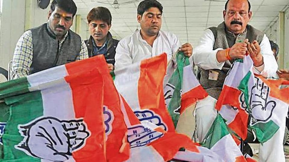 Congress workers prepare for campaigning for the Lok Sabha polls in the party's state headquarters in Dehradun.