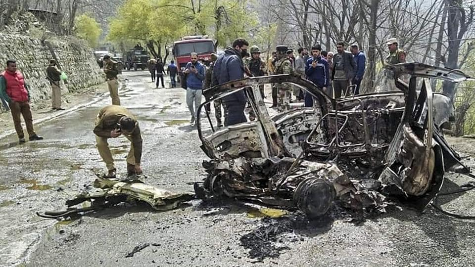Security personnel inspect the mangled remains of a car which exploded near a CRPF convoy on the Jammu-Srinagar highway at Banihal, in Ramban district of Jammu and Kashmir, Saturday, March 30, 2019.