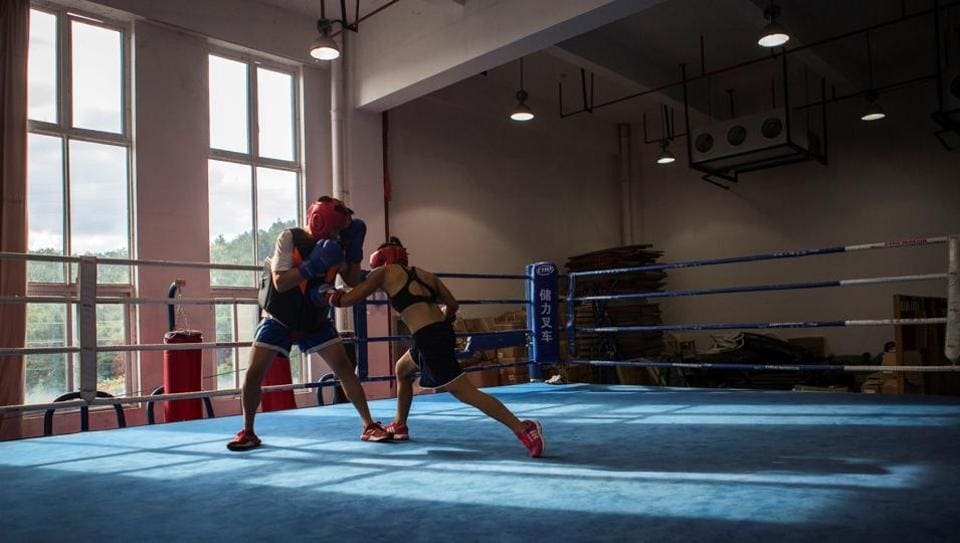 Huang Wensi (R) in action during her final training session in Ningbo, Zhejiang province, China, before she headed to Taiwan for her Asia Female Continental Super Flyweight Championship match held in September 2018. The dreadlocks-wearing Huang is one of a small but growing number of women in China to embrace professional boxing. (Yue Wu / REUTERS)