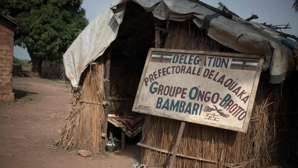 "A sign indicating the house of the traditional group of dancers ""Ongo-Broto"" in Bambari. In the early 2000s, the troupe performed as far away as in France and Algeria. But since then, opportunities have dwindled. The troupe has only one performance lined this year –sounding their trumpets at Bangui's French cultural centre at the end of 2019. (Florent Vergenes / AFP)"