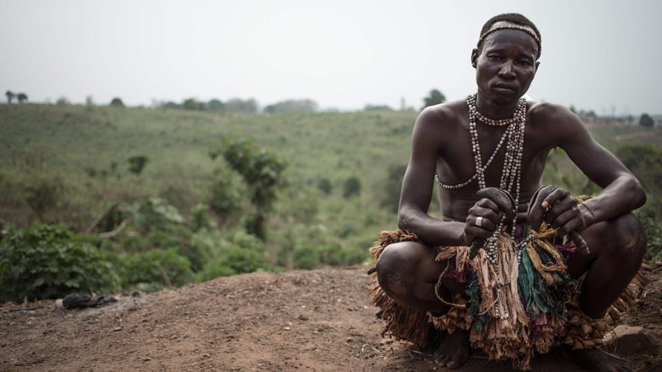 The leader of the group rests on a hill after a performance. Despite being the troupe leader even he was unable to explain the significance this music had to Broto ancestors. The Broto musicians' is a case of tradition trying to find its footing in a culture in transit. (Florent Vergenes / AFP)