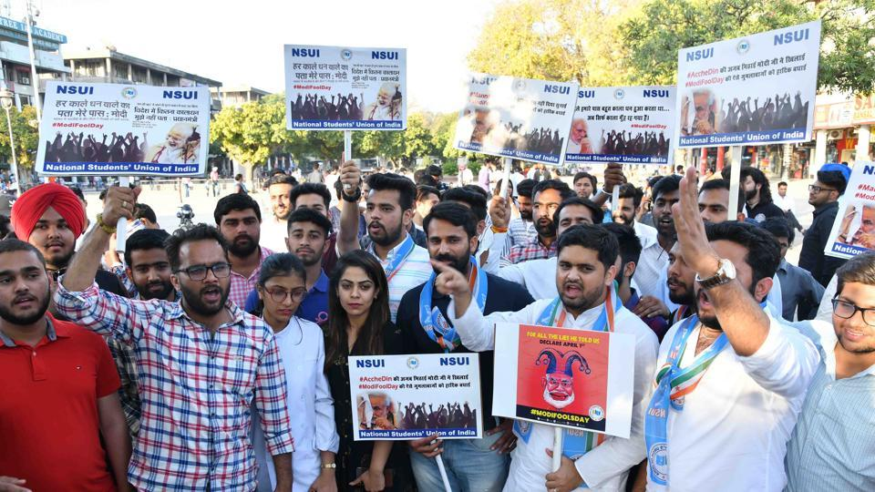 NSUI Members holding protest on April Fool day at plaza sector 17 Chandigarh on Monday