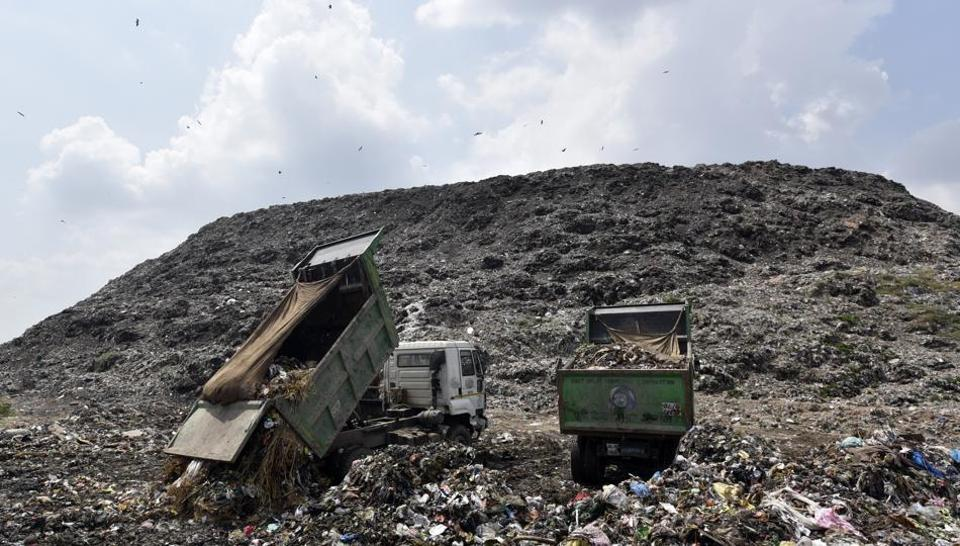 Tucks dumping garbage at Ghazipur Landfill site in New Delhi.