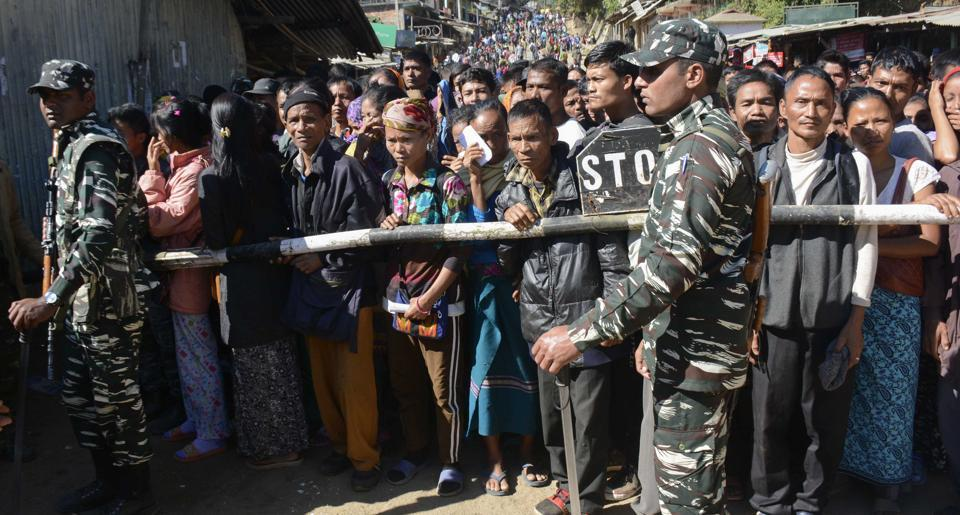Bru voters wait to cross the border between Tripura into Mizoram, to cast their votes in the Mizoram state assembly election at Kanhmun in Mamit district, some 192 kms from Aizawl on November 28, 2018.