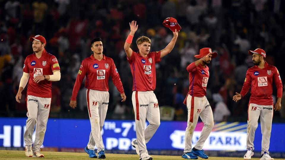Mohali: Kings XI Punjab (KXIP) player Sam Curran along with team members celebrates after claiming the wicket of DC's Colin Ingram during the Indian Premier League 2019