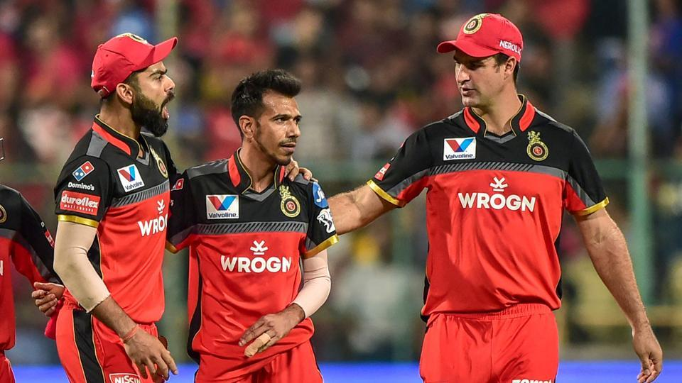 Bengaluru: RCB bowler Yuzvendra Chahal celebrates with captain Virat Kohli and teammate Colin de Grandhomme after dismissing MI batsman Yuvraj Singh