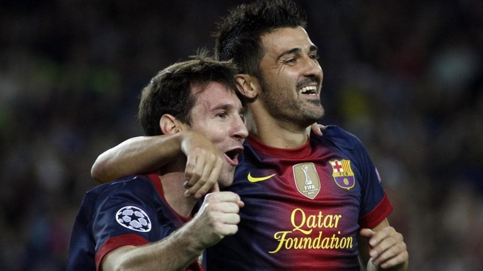 Barcelona's Lionel Messi and David Villa celebrate a goal on September 19, 2012.