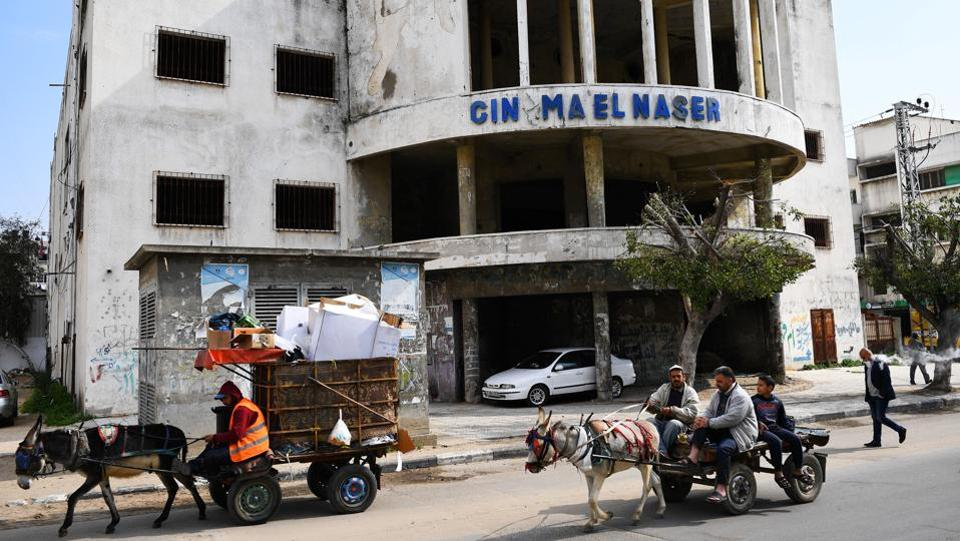 Gaza residents pass an abandoned cinema. Older residents remember watching Egyptian movies in cinemas during the 1960s, but from the 1980s on, fundamentalist Islamist groups burned down such places of public entertainment and closed liquor shops. (Dylan Martinez / REUTERS)