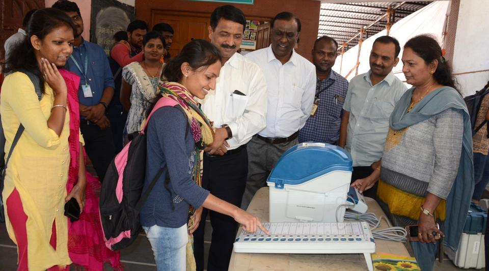 An Election   Commission official showing a  Voter verifiable paper audit trail  (VVPAT) machine ahead of the Lok Sabha elections 2019.