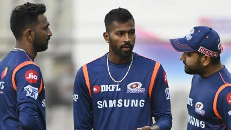 Mumbai Indian's captain Rohit Sharma with teammates Krunal and Hardik Pandya during a practice session.