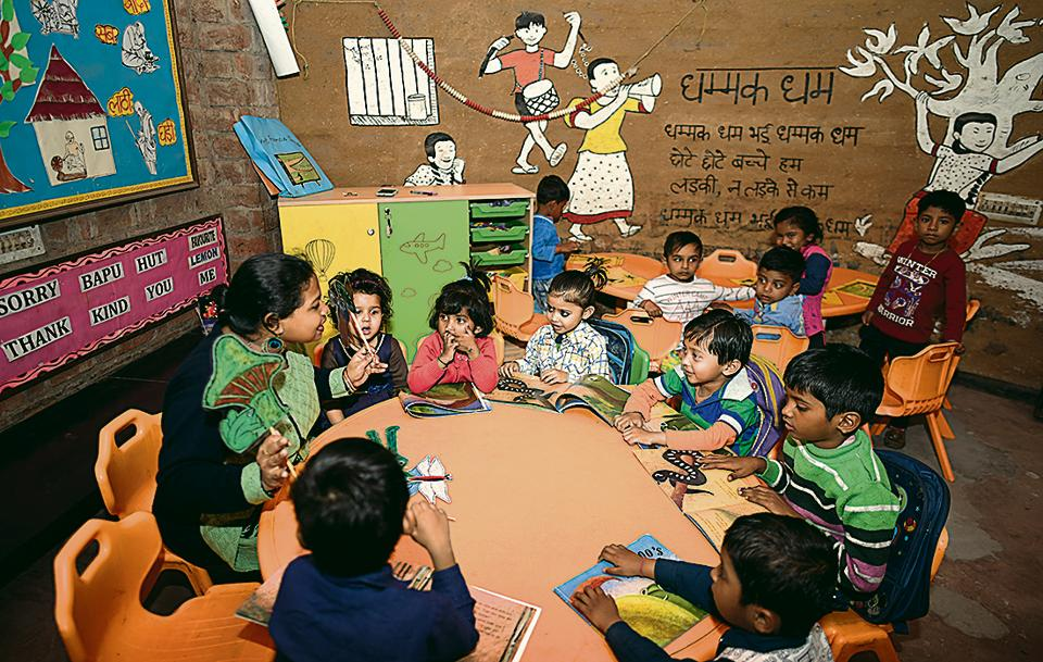 Students at Katha Khazana School at Kaljaji, New Delhi, in the middle of a storytelling session.