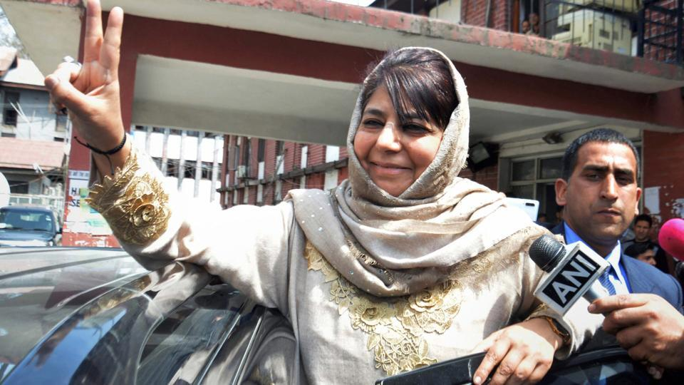 Peoples Democratic Party (PDP) chief and former chief minister Mehbooba Mufti shows victory sign as she leaves after filing her nomination papers from Anantnag, ahead of Lok Sabha elections, at Anantnag district of Kashmir on April 3.
