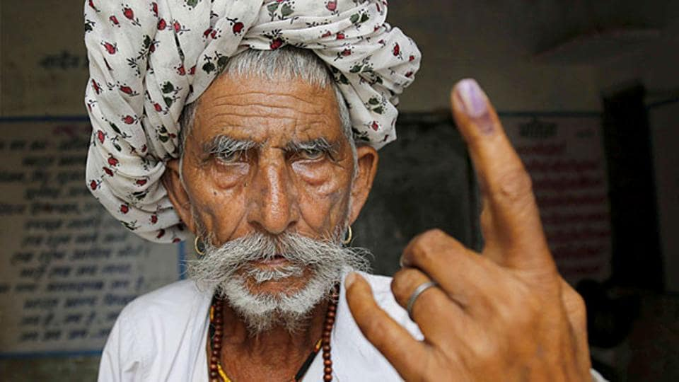 A voter shows his inked finger during Rajasthan local polls.