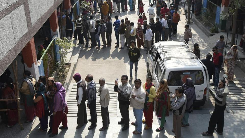 New Delhi, India - Feb. 7, 2015: People waiting in a long queue to cast their vote during the Delhi Assembly Elections, in New Delhi, India, on Saturday, February 7, 2015. (Photo by Sonu Mehta/ Hindustan Times)