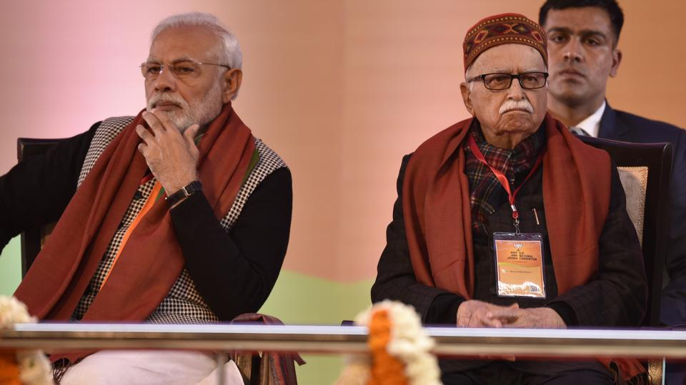 Prime minister Narendra Modi along with senior BJP leader L.K. Advani seen on the first day of BJP National Executive Meet, at Ramlila Maidan, in New Delhi, India, on Friday, January 11, 2019.