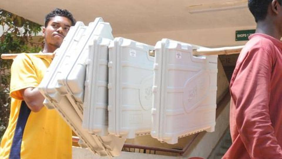 Electronic voting machine(EVM) and VV PAT units being carried to a poll booth.