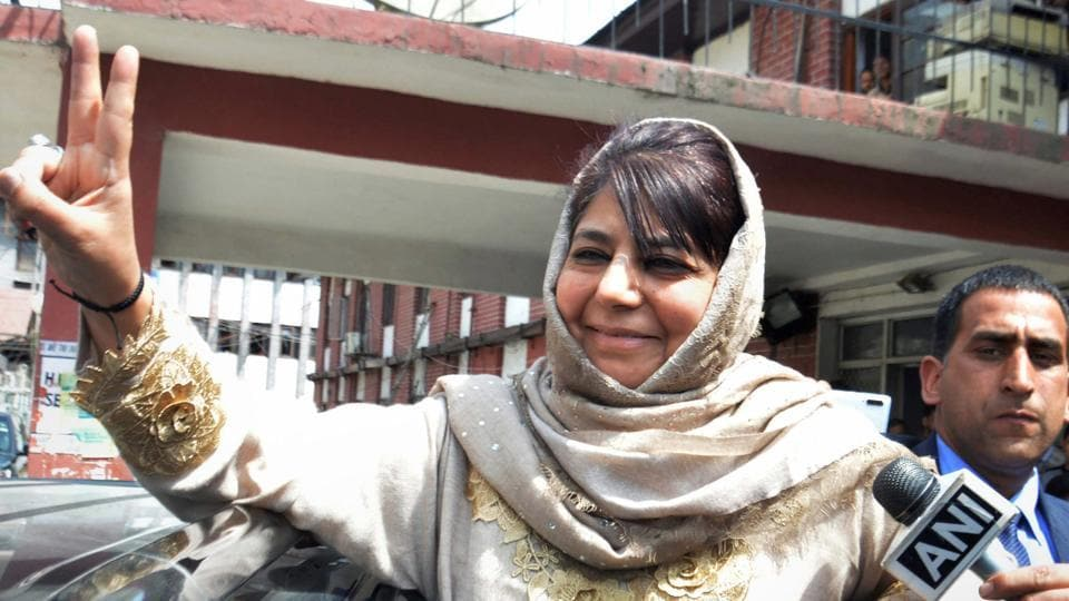 Peoples Democratic Party (PDP) chief and former chief minister Mehbooba Mufti shows victory sign as she leaves after filing her nomination papers from Anantnag, ahead of Lok Sabha elections, at Anantnag district of Kashmir, Wednesday, April 03, 2019.