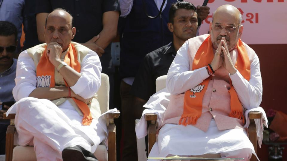 India's ruling Bharatiya Janata Party (BJP) president Amit Shah, right, and Home Minister Rajnath Singh
