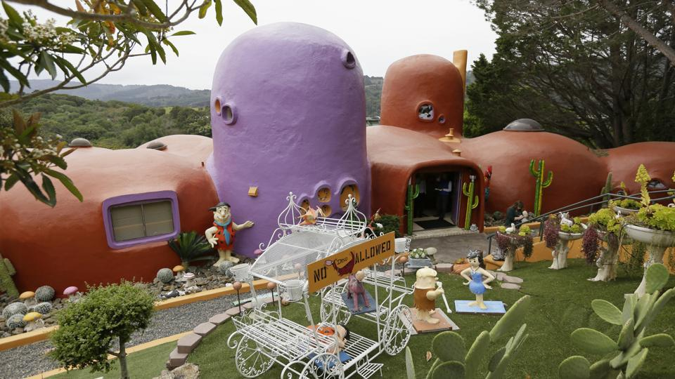 An exterior view of the Flintstone House. The San Francisco Bay Area suburb of Hillsborough is suing the owner of the house, saying that she installed dangerous steps, dinosaurs and other Flintstone-era figurines without necessary permits.
