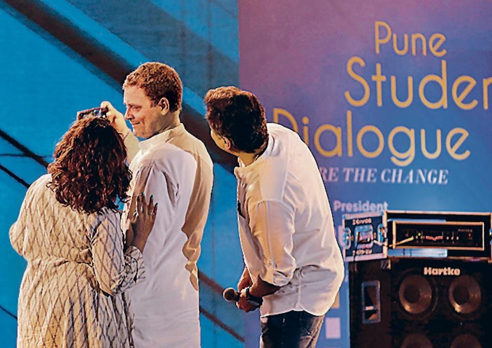 Rahul Gandhi takes a break from his interaction with students at Laxmi Lawns in Magarpatta, Pune, on Friday, to take a selfie with RJ Malishka (left) and Marathi actor Subodh Bhave, both of whom anchored the event.