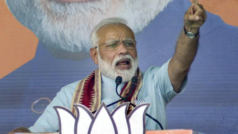 Prime Minister Narendra Modi addresses during 'Vijay Sankalp Samavesh' public meeting ahead of Lok Sabha elections, at Bhawanipatna in Kalahandi, Tuesday, April 02, 2019.
