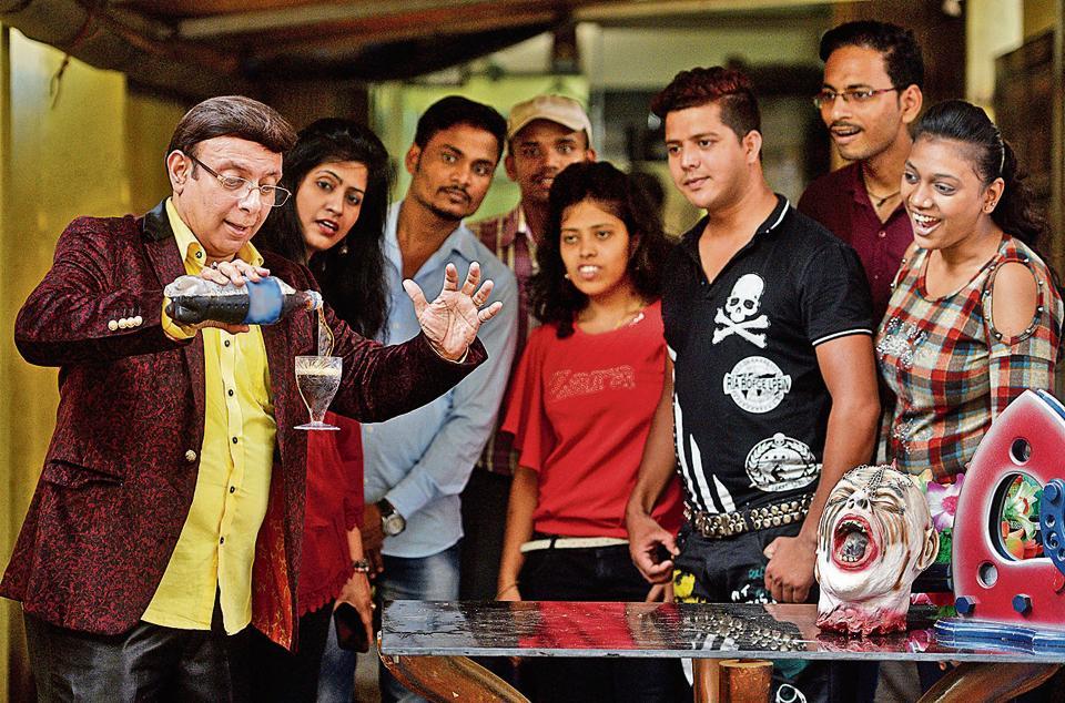 Magician Mandar Patil showing a  magic trick to his students at Andheri (W) in Mumbai